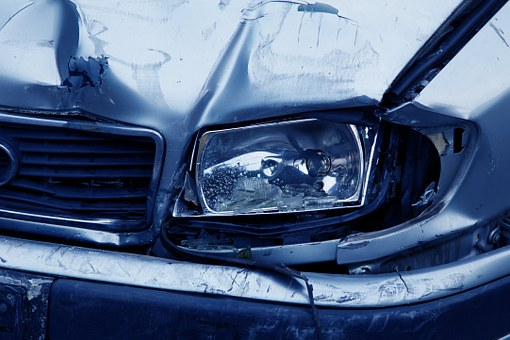 damaged headlamp on a car following a crash