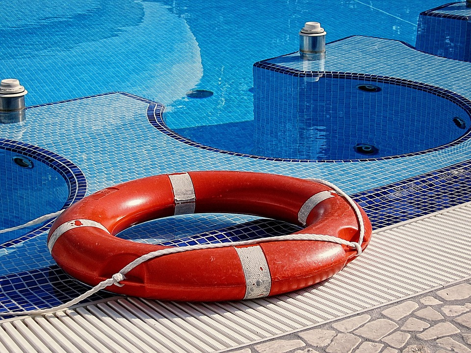 Life ring on the side of a swimming pool